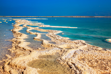 Path from the evaporated salt on a water surface. The Dead Sea at coast of Israel 版權商用圖片