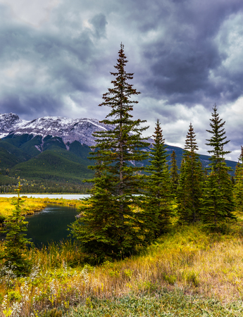 Rocky Mountains of Canada. Heavy clouds looming over the valley along the Pocahontas road. Concept of active and photo-tourism