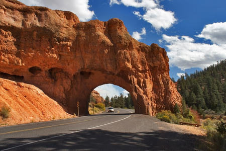 A red canyon and road in state of Utah in the USA