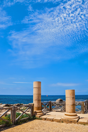 Ancient columns from the Byzantine period on the Mediterranean coast. National Park Caesarea, Israel