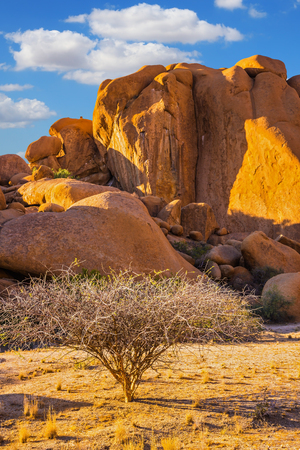 Concept of extreme and ecological tourism. The granite outcrops in the Desert Namib. Stone of Spitzkoppe, Namibia. Play of light and shadow on the rocks Imagens - 112630369