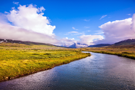 Fjord in Iceland among flat tundra shores.  The concept of extreme northern tourism