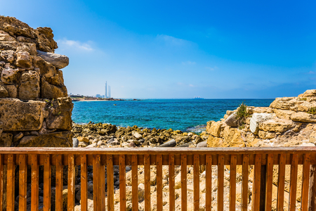 Exit to the sea. The port of King Herod in ancient Caesarea, Israel. Concept of archeological and historical tourism