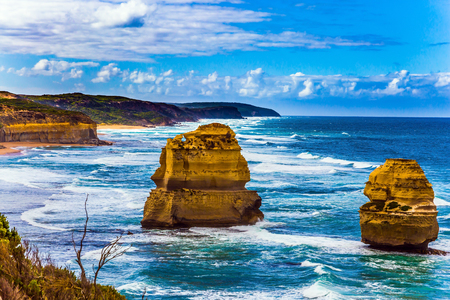 Travel to Australia. Rocks of the coastal strip of the famous Twelve Apostles. The morning on the Pacific coast near Melbourne. The concept of active and phototourism