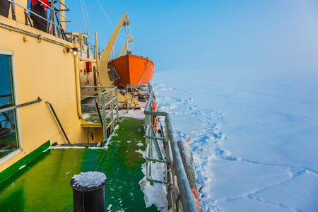 Arctic in winter. Dim northern sun. Excursion to the Arctic sea icebreaker. Unforgettable excursion to the arctic tourist cruise. The concept of active and extreme tourism Stok Fotoğraf