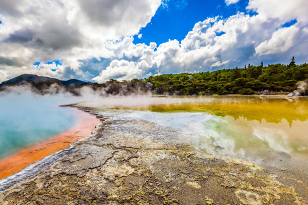 Picturesque lake of multicolored thermal waters evaporates in the air. The magic country of hot waters is Wai-O-Tapu. New Zealand, North Island. The concept of active and phototourism