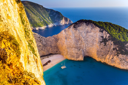 Famous Shipwreck Beach. Romantic fabulous sunset. The picturesque coast of the Greek island of Zakynthos. The concept of active, ecological and photo tourism