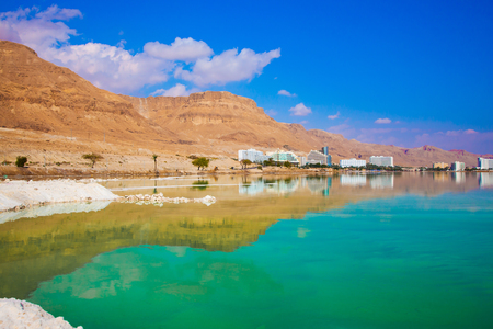 Turquoise smooth water and midday heat in the Dead Sea resort in Israel. The concept of medical and ecological tourism