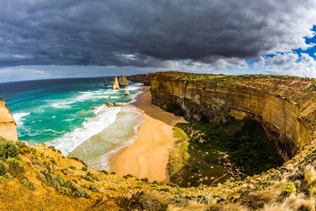 Fabulous light on the Pacific coast near Melbourne. Famous rocks Twelve Apostles in ocean waves surf. Travel to Australia. The concept of active and phototourism