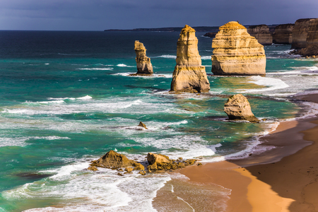 Travel to Australia. Magnificent morning light on the Pacific coast near Melbourne. Famous rocks Twelve Apostles in ocean waves surf. The concept of active and phototourism Stock Photo