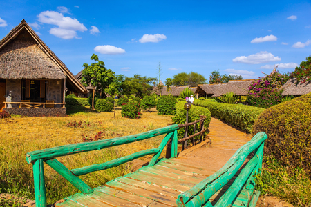 Fairy lodge in the park. Kenya. Bungalows with grass roofs. The concept of ecological, active and photo tourism