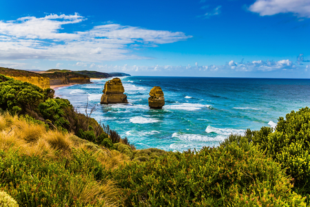The morning on the Pacific coast near Melbourne. Rocks of the coastal strip of the Twelve Apostles. The Great Ocean Road. The concept of active and phototourism