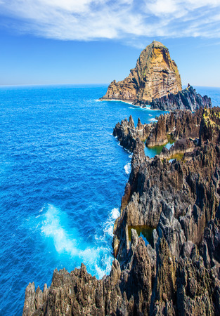Concept of exotic and ecological tourism.  Magic travel on the volcanic island of Madeira. Picturesque rocks and stones  at coast of Atlantic