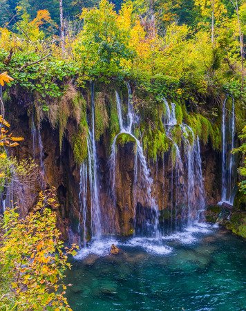 Waterfalls are reflected in azure water of the lake. Croatia. Travel to the magic country of Plitvice lakes. The concept of ecological, active and phototourism Stockfoto