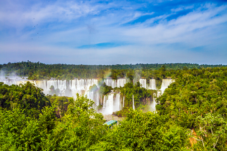 Iguazu Falls. Waterfalls of the Brazilian national park Iguazu. Boiling water creates a watery dust and a rainbow. The concept of ecological and extreme tourism