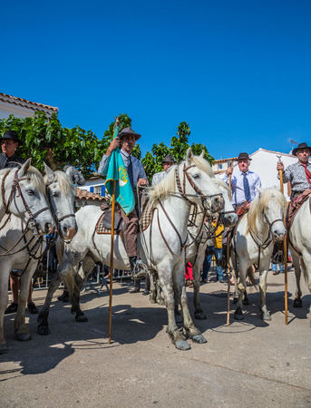 Sent-Mari-de-la-Mer, Provence, France - May 25, 2015. Guards on  white horses are waiting for the parade. World Gypsy Festival. The concept of ethnographic and active tourism