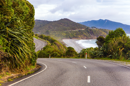 West Coast of the South Island. Incredible journey to the ends of the world. Picturesque road to Pancake Rock - natural wonder of New Zealand. The concept of ecological, active and photo tourism Reklamní fotografie