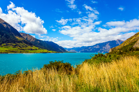 Dreamland New Zealand. Mountains surround a magical lake Hawea with turquoise smooth water. The concept of ecological, phototourism and active tourism