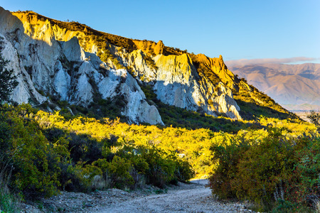 Fantastic country of New Zealand. Travel on the South Island. High white Clay cliffs with sharp tops at sunset. Warm sunny day. Concept active, exoti, eco and phototourism