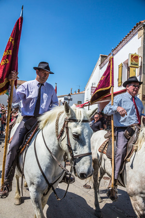 Sent-Mari-de-la-Mer, Provence, France - May 25, 2015. Two guards on  white horses are waiting for the parade of World Gypsy Festival. The concept of ethnographic and active tourism