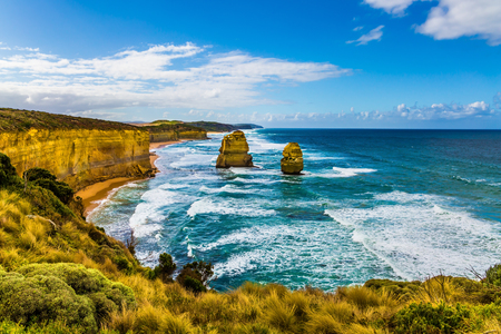 The Great Ocean Road. Rocks of the coastal strip of the famous Twelve Apostles. The morning on the Pacific coast near Melbourne. Travel to Australia. The concept of active and phototourism
