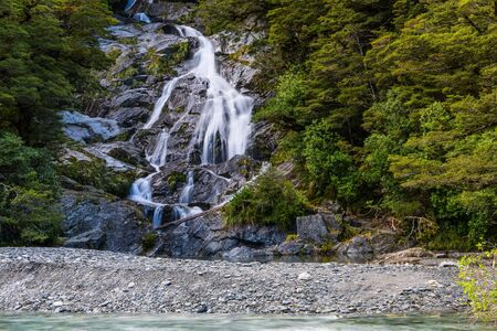 Great trip to New Zealand. Scenic fan-shaped waterfall Fantail. West Coast of the South Island. The concept of active, ecological, exotic and phototourism 版權商用圖片 - 125594591