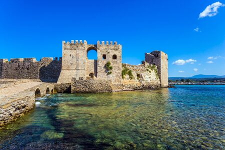 Powerful walls and towers are made of hewn stones. The picturesque ancient port Methoni in the Greek Mediterranean. The concept of active, photo and historical tourism