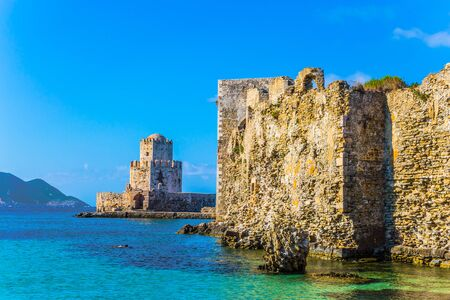 Venetian fort castle Methoni on the Greek Peninsula Peloponnese. Magnificent watchtower built on long cape in the sea. The concept of active, photo and historical tourism Foto de archivo