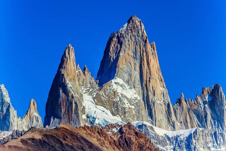 Picturesque mountain range, illuminated by the midday sun. Fitzroi - mountain peak in Patagonia in the border area between Argentina and Chile. The concept of extreme, active and photo tourism