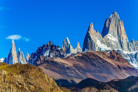 Fitzroi or Chaltel - mountain peak in Patagonia between Argentina and Chile. Magnificent mountain range, illuminated by the midday sun. The concept of extreme, active and photo tourism 写真素材