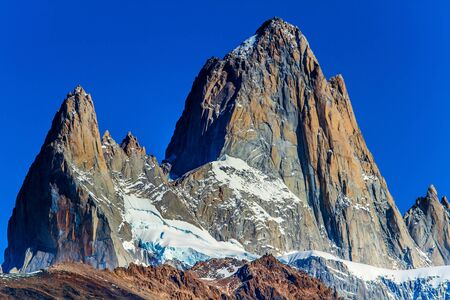 Picturesque mountain range, illuminated by the sun. Fitzroi - mountain peak in Patagonia in the border area between Argentina and Chile. The concept of extreme, active and photo tourism Stock Photo - 129019506