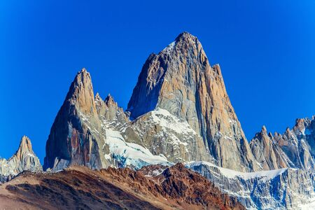 Fitzroi peak in Patagonia in the border area between Argentina and Chile. Magnificent mountain range, illuminated by the midday sun. The concept of extreme, active and photo tourism 写真素材