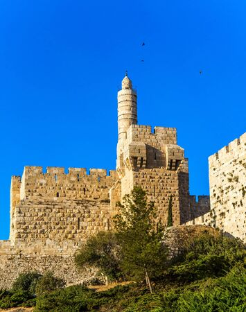 Ancient Citadel - Tower of David. Hot summer sunset. Monumental walls of Jerusalem. The height of the walls is 12 meters. The concept of historical, religious, pilgrim and photo tourism