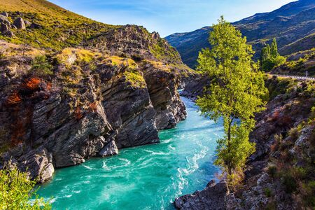 Scenic Spots of New Zealand. On the way to Queenstown. Magnificent mountainous rapid river with melted glacial water and steep banks. The concept of active, ecological and photo tourism