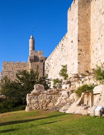 Hot summer sunset. Monumental walls of Jerusalem. Ancient Citadel - Tower of David. The height of the walls is 12 meters. The concept of historical, religious, pilgrim and photo tourism