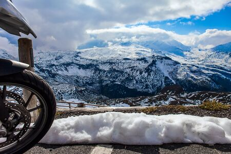 The first snow fell on Grossglockner Alpine Road. Austria. The roadside is fenced. The road consists of 36 serpentine turns.  Ecological, active and photo tourism concept
