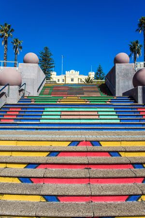 Cape Town is a fabulous port city on the shores of two oceans. Multi-colored staircase. Promenade and beach in Cape Town. The concept of active, exotic and photo tourism Stock Photo