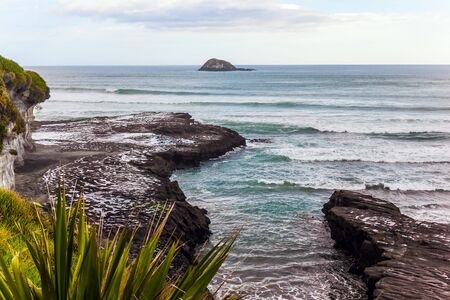 Muriway Beach is a black sand beach. The west coast of the North Island of New Zealand. Sunset. The concept of active, environmental and photo tourism 版權商用圖片