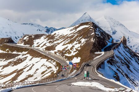 Austria. Grossglockner sightseeing road. The first snow fell on Alpine Road. The roadside is fenced. The road consists of 36 serpentine turns. Ecological, active and photo tourism concept