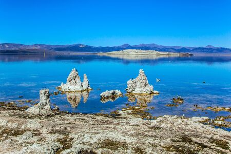 Mono Lake is a natural wonder of the world. Picturesque lake with lime-tuff towers of fancy shape. Evening by the lake. The concept of active, ecological, exotic and photo tourism