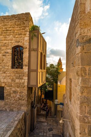 Century masonry walls. Sunset. Old Yaffo - one of the most ancient cities of the world. Warm summer evening. Concept active, informative and photo of tourism