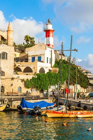Sunset. Yachts on an anchor in Yaffo port. Old Yaffo - one of the most ancient cities of the world. Concept active, informative and photo of tourism