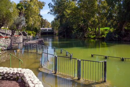 The place of symbolic baptism is equipped with walkways and partitions. Yardenit, Israel. The exit of the Jordan River from Lake Galilee.