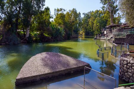 The Jordan River. Yardenit, Israel. Fine warm sunny February day. The place of the symbolic ceremony of baptism. Religious and photo tourism concept