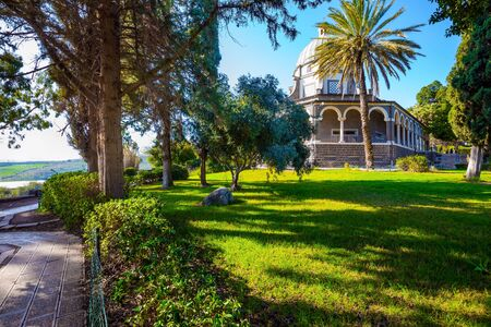 Blooming huge park around the monastery. The Catholic Church of the Beatitudes of the Italian female Franciscan monastery on Mount Bliss. The Sea of Galilee. Israel. The concept of religious pilgrimage
