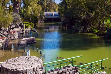 Yardenit, Israel. The center is a symbolic rite of baptism of believers of the Greek Orthodox Church and Catholics. The exit of the Jordan River from Lake Galilee. Religious, ethnographic and photo tourism concept