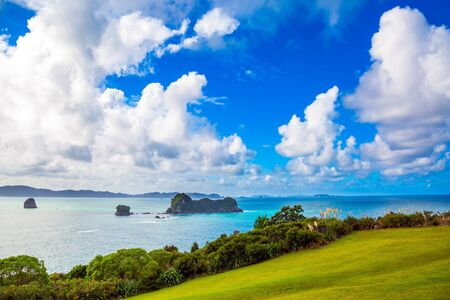 Pacific Ocean, New Zealand. Road to the Cathedral Cove on the North Island. Incredible clouds over the evening tide. The concept of active, exotic, ecological and photo tourism