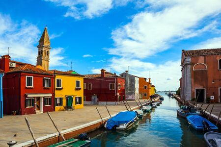 Inclined tower - a landmark of the island of Burano. Burano is island of multi colored bright houses near Venice. Province of Veneto. The concept of cultural, historical and photo tourism