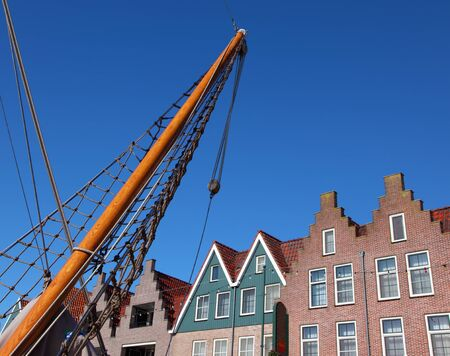 At home on ancient quay and seaport in the Dutch small city of Volendam. Clear October day