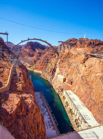 The construction of the longest concrete arch bridge in 2009. USA. Grandiose engineering decision. The lower course of the Colorado River. The concept of active and photo tourism